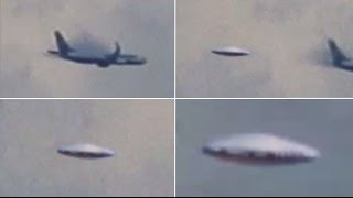 UFO Out Of The Cloud Near The Plane, April 25, 2014