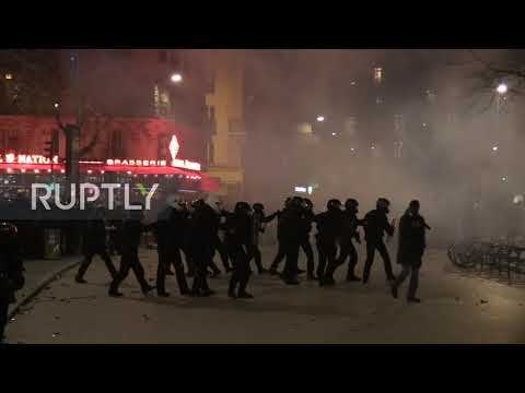 france:-protesters-hurl-flares-at-police-at-paris-pension-reform-demo