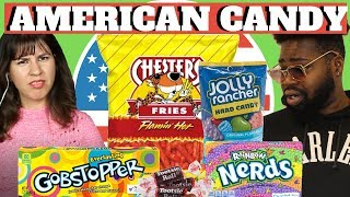 BRITISH PEOPLE TRY AMERICAN CANDY (TOOTSIE ROLLS, NERDS, JOLLY RANCHER, CHESTERS & GOBSTOPPER)