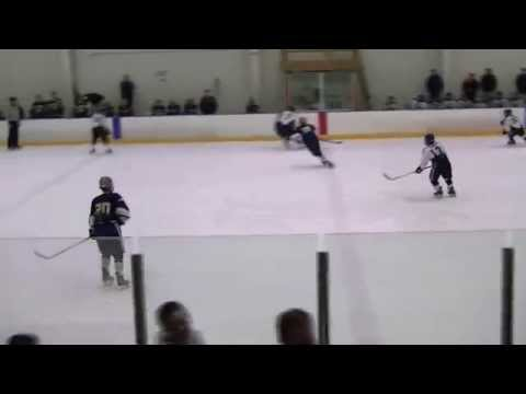 Tommy Mason dark #8 Salesianum works the puck in and snaps a wrister!!