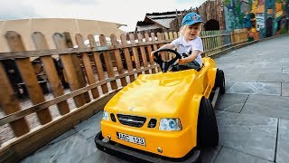 Cute Kid Driving a Yellow Car
