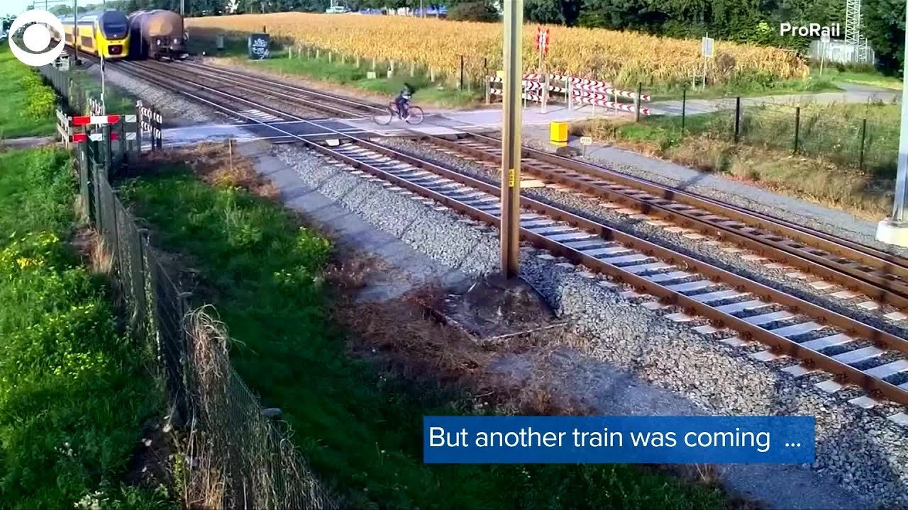 Web Extra Train Barely Misses Cyclist