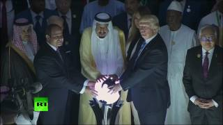 RAW  Internet freaks out after Trump & King Salman pose at 'magic orb' in weird moment