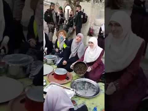 Iftar Palestinian women break their fast in front of Israel's army