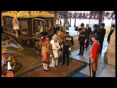 The Queen arrives at the Palace of Westminster to deliver her 62nd