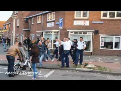 05-06-2012: Onrust bij omstanders bij inval arrestatieteam - Hildebrandstraat, Den Haag