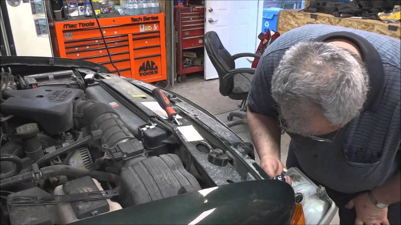 2003 ford ranger headlight bulb replacement