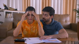 Worried Indian Couple - Calculating pending taxes and bills. Modern-day lifestyle issues - Financial Problem