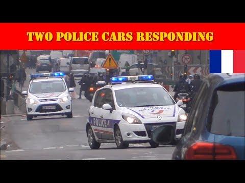 2 véhicules de police remontent la rue de Rivoli