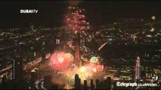 Dubai lights up world's tallest building in New Year firework show