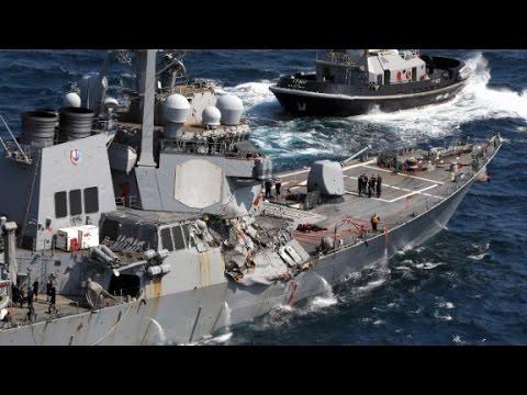 Officials probe cause of Navy ship crash