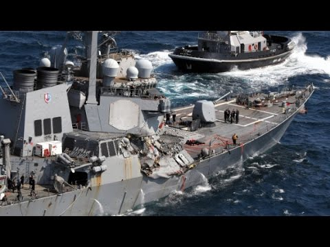 Officials probe cause of Navy ship crash