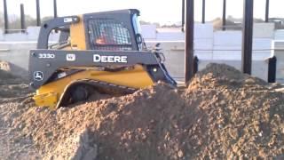 John Deere 333D Track Loader back filling with sand