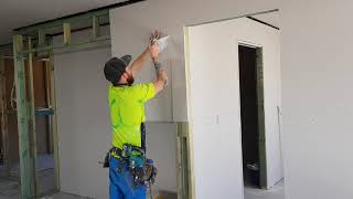 Watch Fast Drywall Fixing Crew Hanging Sheets on walls
