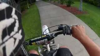 jumping the backyard pit bike ramp