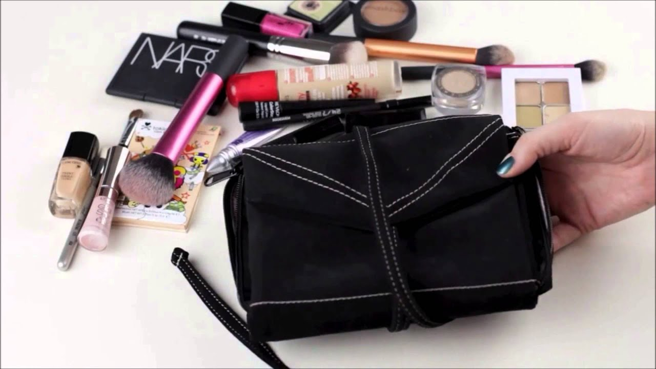 I did an in depth review of this bag about a year and a half ago here, and am still a huge fan of my Hold Me bag today. I use this sophisticated and cleverly created makeup bag EVERYTIME I .