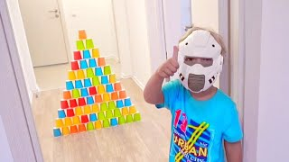 Lev plays with colored toy cups for children.