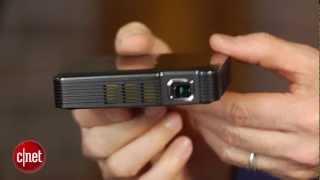 Brookstone's mini projector plays big