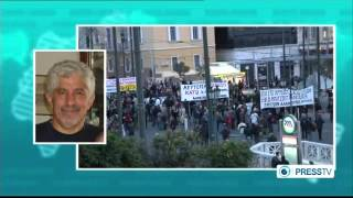 Thousands of protesters marched in central athens against a disputa...