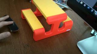 Fingerboarding on little tikes picnic table