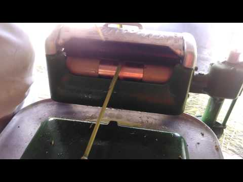 Using 1929 maytag to press sorghum juice