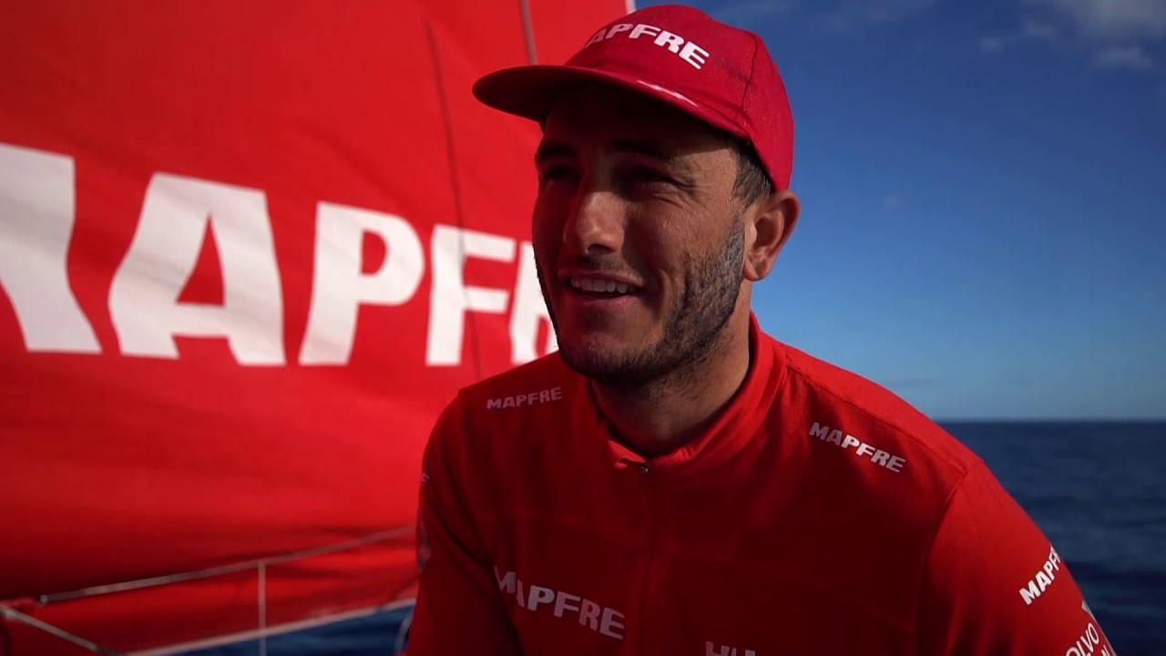 "Pablo, by the mast as MAPFRE sails in 6 knots of wind, talks in Spanish. Neti talks in Spanish. Tamara talks in Spanish. Blair, on the foredeck: We've still got 800 miles to go. Brunel is just finishing now. They sailed a very good leg. Hopefully Brunel can hang on (against Dongfeng). Selfish for us, but we want to keep a couple more points away from Dongfeng. Below, Pablo through food bags, and Xabi at the nav station announces that Brunel won. Pablo: ""yes, yes."" Rob announces it to the cockpit: ""Brunel won."" Xabi talks in Spanish about the result."