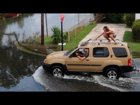FLORIDA IS SINKING!! Surfing The Streets
