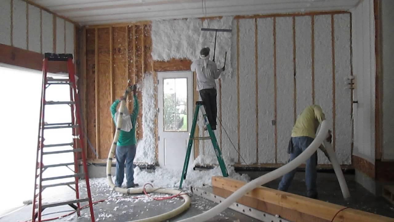 Spray In Fiberglass Being Installed In Vertical Wall
