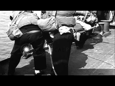 LCVP (Landing Craft, Vehicle, Personnel) unloads casualties on LST (Landing Ship,...HD Stock Footage