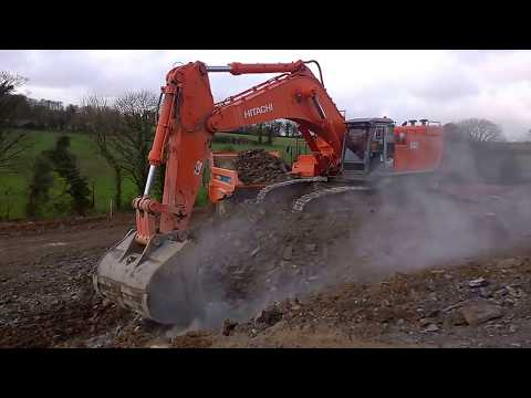 Hitachi 870 Excavator Loading Dumpers On A Road Construction Site #1