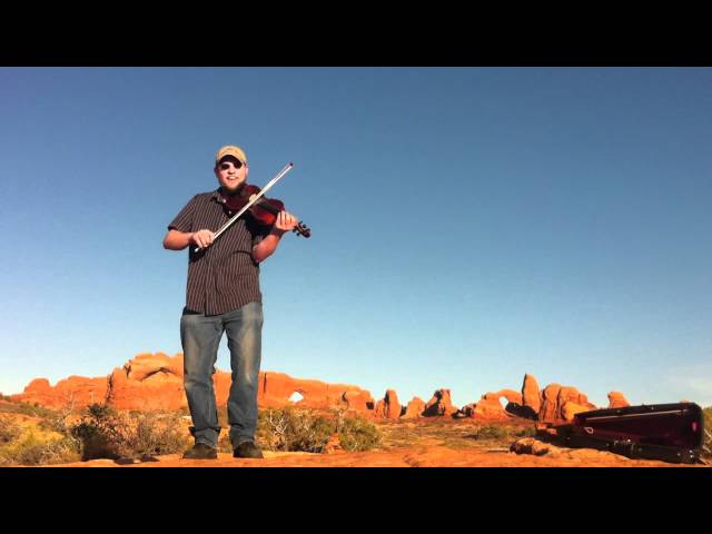 Fiddle in Arches National Park ~ Stuck in a Log by Andy Reiner