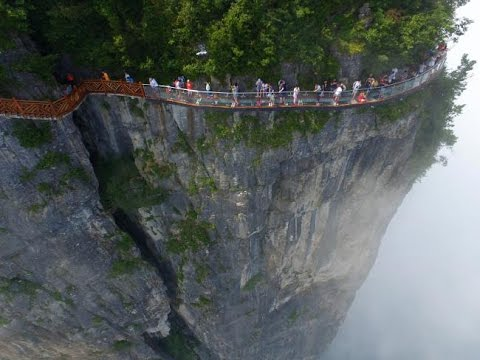 Meet the Chinese workers who risk their lives building cliff walks for a living