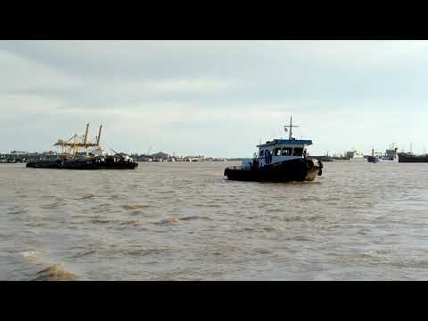 The Tug boat and the Barges in the Chaopraya River, Thailand