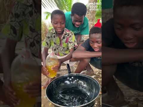 African Village boys making crab and egg dish