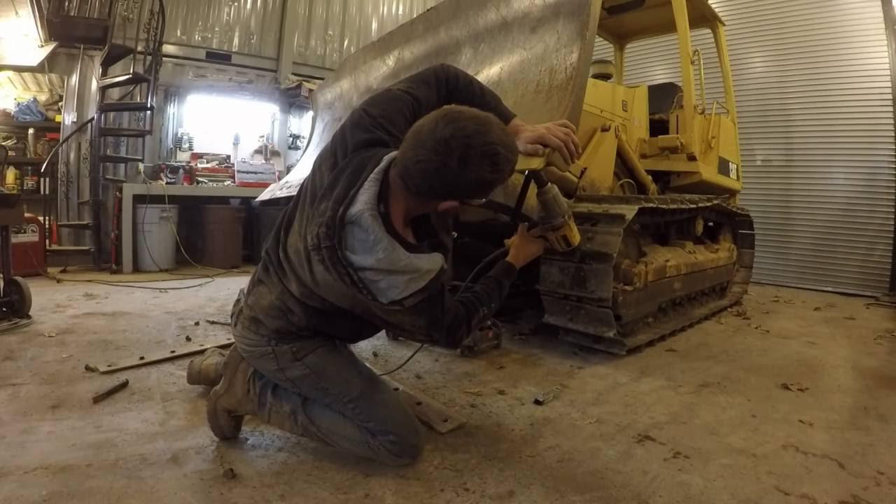 Installing new cutting edge on a bulldozer