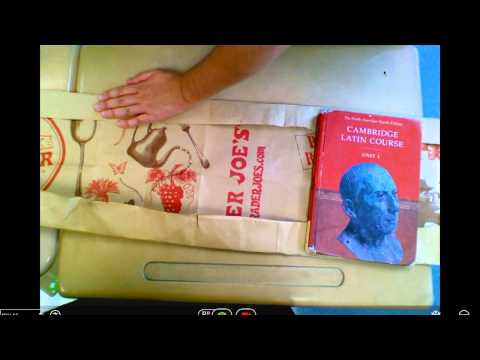 How to cover a book with a brown paper bag.