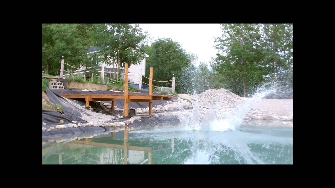 6 building your own private beach swimming pond youtube for Making a pond in your backyard