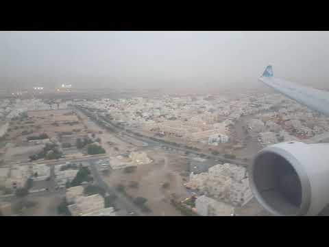 Oman Air Airbus A330-200 Wingview landing in Muscat Internat