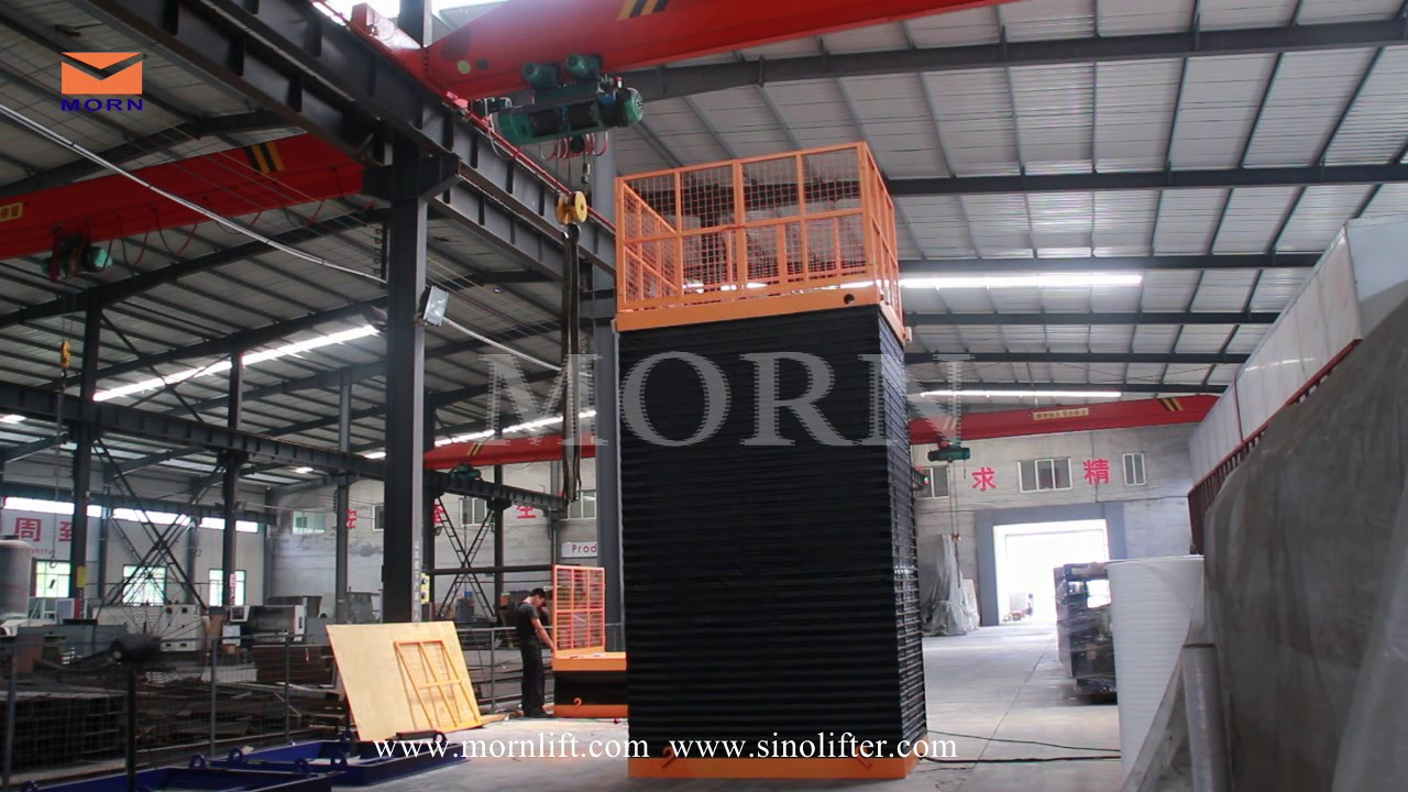 Video Stationary Scissor Lift With Safety Skirt From Morn Lift Lifting Up And Down