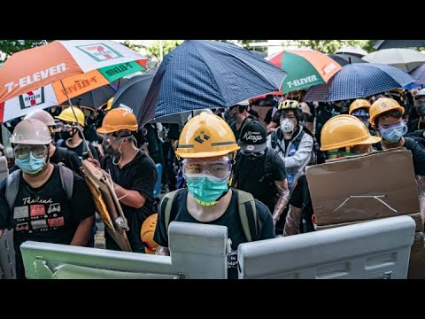 Hong Kong Falls Into Recession as Protesters Don Masks for ...