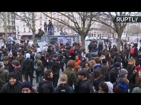 Clashes break out in Paris during rally against Macron's public sector reforms