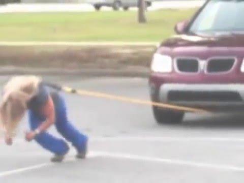 画像: Strength athlete / strong woman competitor During training practice pulling SUV www.youtube.com