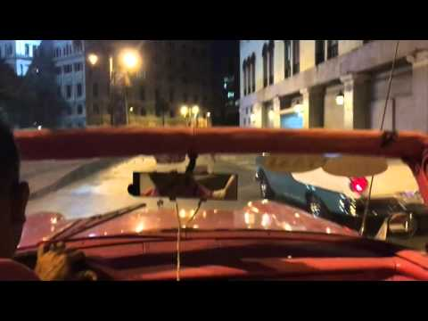 Riding a pink convertible through Havana