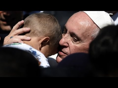Pope takes 12 refugees back to Vatican