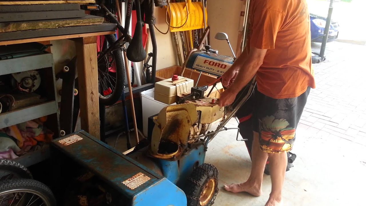 how to put chains on snowblower