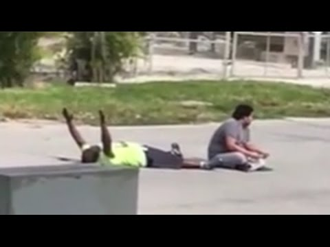 Florida police shoot unarmed caregiver with hands up