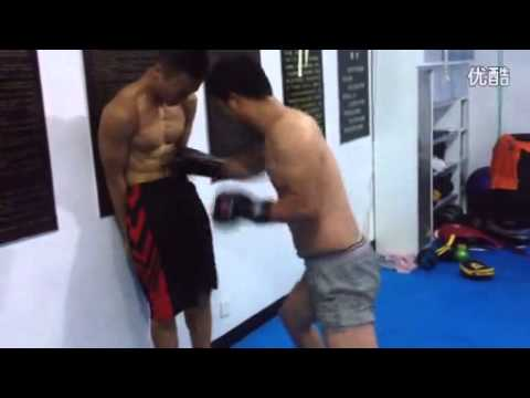 Asian gut punching