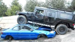Hummer H1 running over cars.