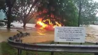 Dramatic Video Shows Floods Sweep Away Burning House