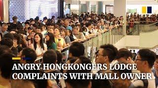 Hong Kong protesters besiege complaints desk at Sha Tin shopping centre